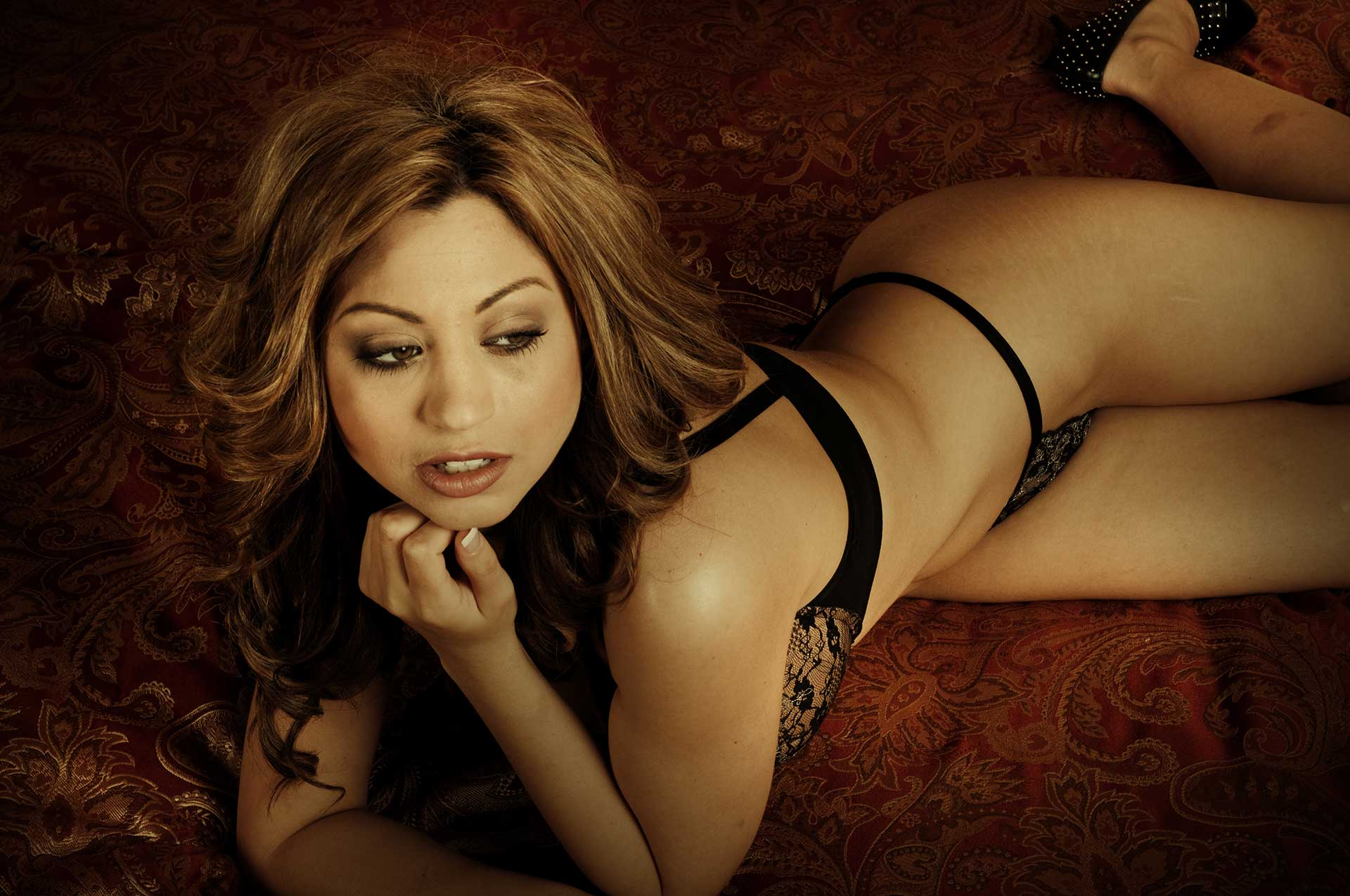 Stripper laying in lingerie on couch