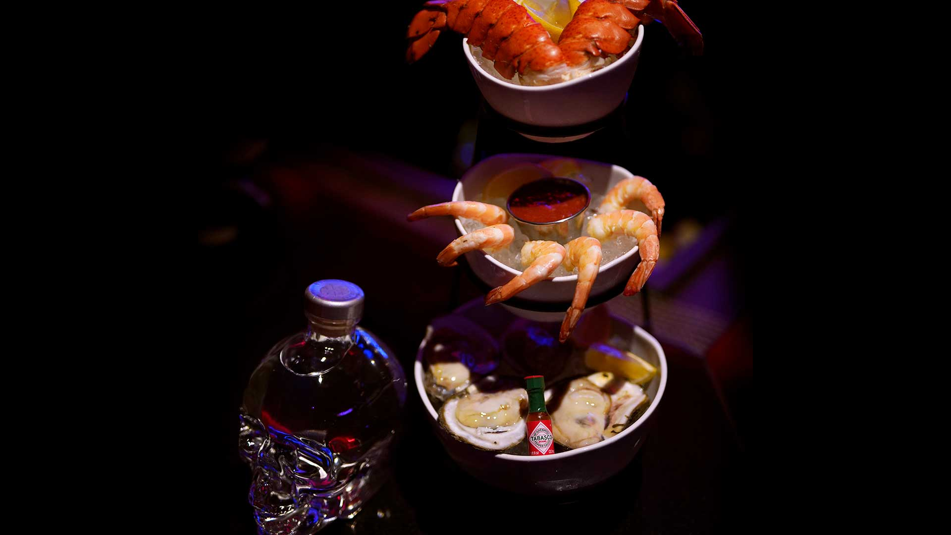 Image of seafood tower and crystal skull vodka