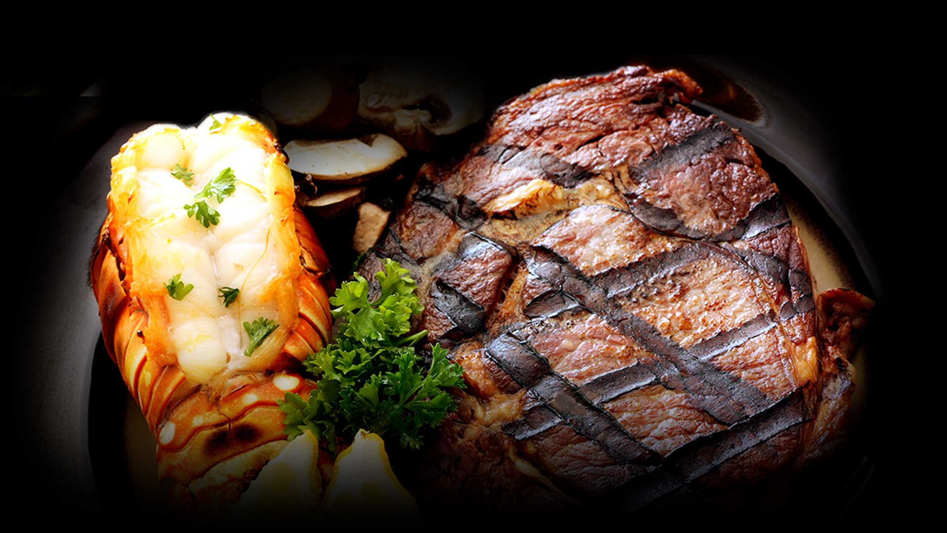 Image of lobster tail and 10oz ribeye for The Men's Club of Dallas Surf and Turf Saturdays