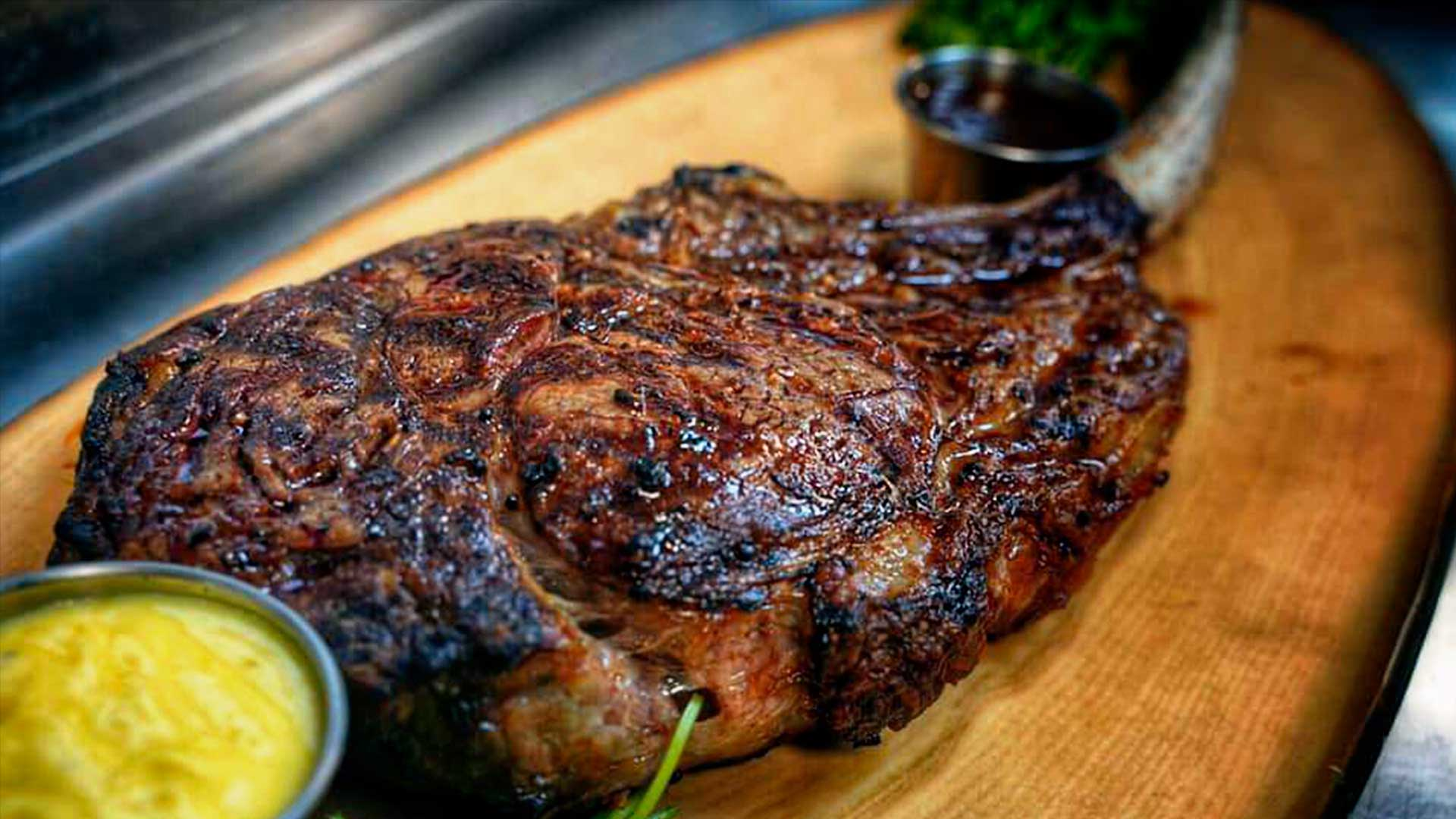 Image of juicy 50 oz Tomahawk Steak available at The Men's Club every Thursday